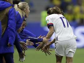 United States' Tobin Heath, right, celebrates with her teammates after their team's second goal during the Women's World Cup Group F soccer match between Sweden and the United States at Stade Oc�ane, in Le Havre, France, Thursday, June 20, 2019. (AP Photo/Alessandra Tarantino)