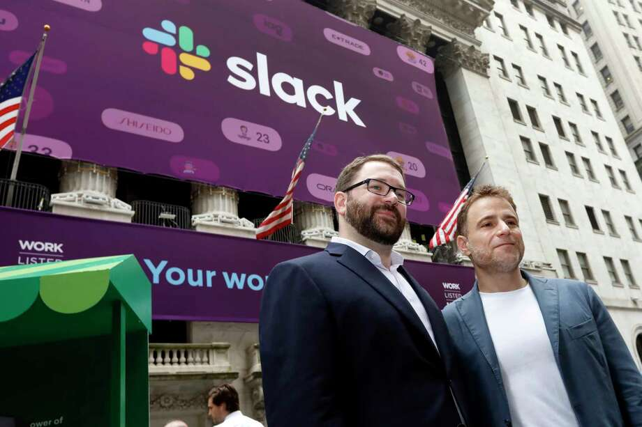 Slack co-founders Cal Henderson, left, and Stewart Butterfield pose for photos outside the New York Stock Exchange before their company's IPO, Thursday, June 20, 2019. (AP Photo/Richard Drew) Photo: Richard Drew / Copyright 2019 The Associated Press. All rights reserved.