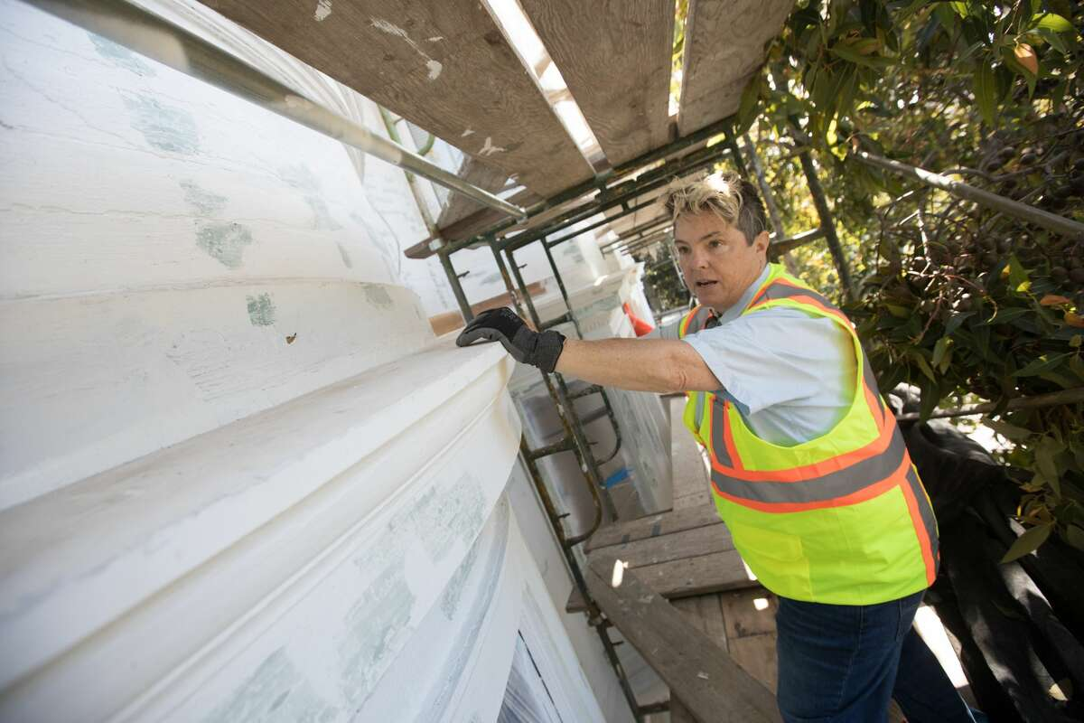 Nita Riccardi checks on the repainting project being done on 450 Duboce Ave in San Francisco. Riccardi owns Winning Colors which specializes in rehabilitating and painting San Francisco's Victorian houses and buildings.