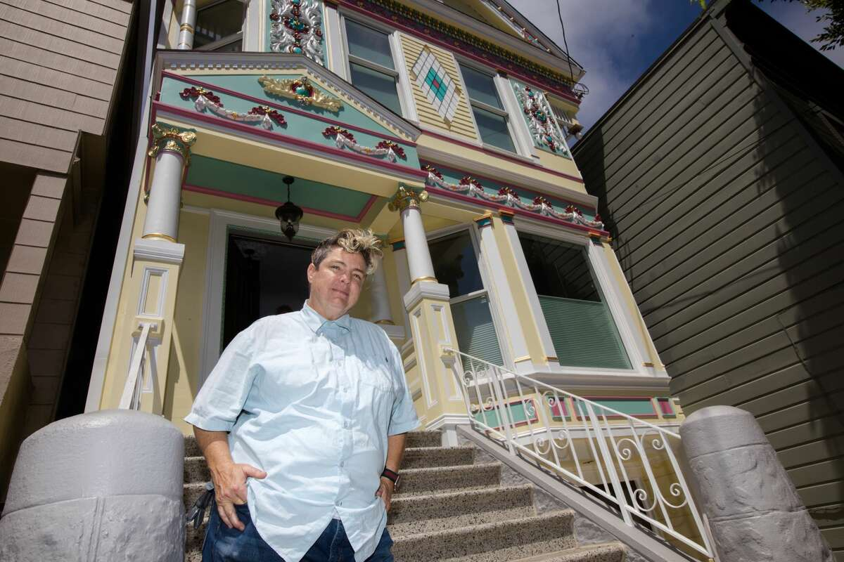 Nita Riccardi, owner of Winning Colors, stands outside of a house on Cole Street that her company painted. Winning Colors specializes in painting San Francisco's Victorian houses and buildings.