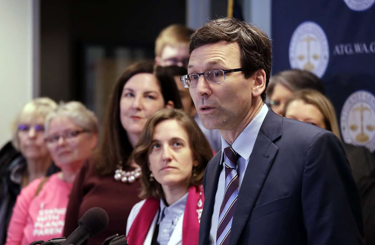 FILE - In this Feb. 25, 2019, file photo, Washington state Attorney General Bob Ferguson speaks at a news conference announcing a lawsuit challenging the Trump administration's Title X