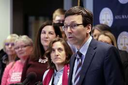 """FILE - In this Feb. 25, 2019, file photo, Washington state Attorney General Bob Ferguson speaks at a news conference announcing a lawsuit challenging the Trump administration's Title X """"gag rule"""" in Seattle. A U.S. appeals court says new Trump administration rules imposing additional hurdles for women seeking abortions can take effect. Courts in Washington, Oregon and California had blocked the rules from taking effect. The rules ban taxpayer-funded clinics from making abortion referrals and prohibit clinics that receive federal money from sharing office space with abortion providers. The 9th U.S. Circuit Court of Appeals on Thursday said the lower courts appeared to have gotten the rulings wrong. (AP Photo/Elaine Thompson, File)"""
