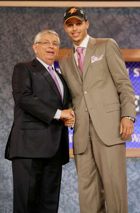 NBA commissioner David Stern, left, poses with Davidson's Stephen Curry, who was picked by the Golden State Warriors during the first round of the NBA basketball draft Thursday, June 25, 2009, in New York. (AP Photo/Seth Wenig) Photo: Seth Wenig / Associated Press 2009
