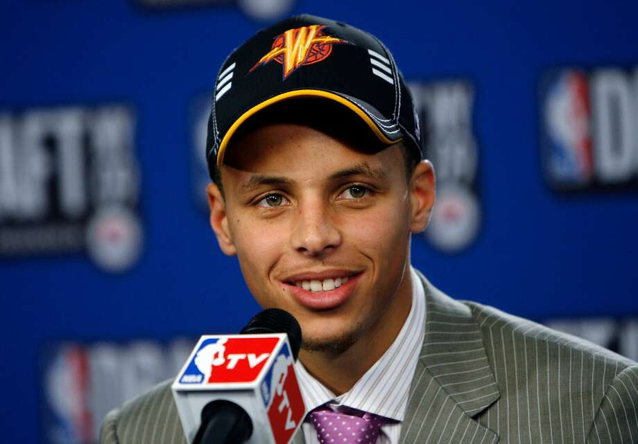 Davidson's Stephen Curry takes questions in the interview room after being selected by the Golden State Warriors in the NBA basketball draft Thursday, June 25, 2009, in New York. (AP Photo/Jason DeCrow) Photo: Jason DeCrow / AP