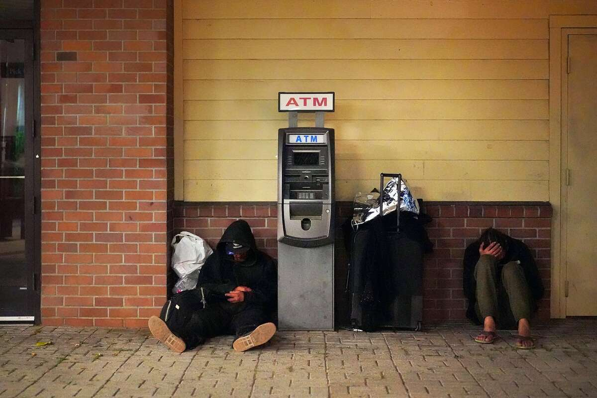 FILE - In a tweet that has since gone viral, a local journalist accused a Castro Japanese restaurant for posturing as inclusive while using anti-homeless architecture. Homeless men at the Pittsburg BART on Thursday, June 6, 2019, in Pittsburg, Calif.