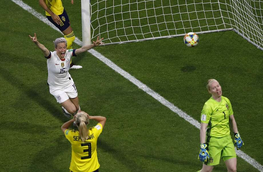 U.S. midfielder Megan Rapinoe celebrates the Americans' second goal, an own goal let in by Sweden goalkeeper Hedvig Lindahl (right) in Le Havre, France, Thursday. Photo: Christophe Ena / Associated Press