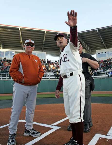SPORTS Texas State coach Ty Harrington explains the field to Texas Coach Augie Garrido as Bobcat Field opens in San Marcoson Tuesday, March 3, 2009. Tom Reel/Staff