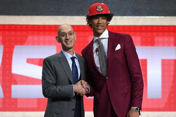 NEW YORK, NEW YORK - JUNE 20: Jaxson Hayes poses with NBA Commissioner Adam Silver after being drafted with the eighth overall pick by the Atlanta Hawks during the 2019 NBA Draft at the Barclays Center on June 20, 2019 in the Brooklyn borough of New York City. NOTE TO USER: User expressly acknowledges and agrees that, by downloading and or using this photograph, User is consenting to the terms and conditions of the Getty Images License Agreement. (Photo by Sarah Stier/Getty Images)