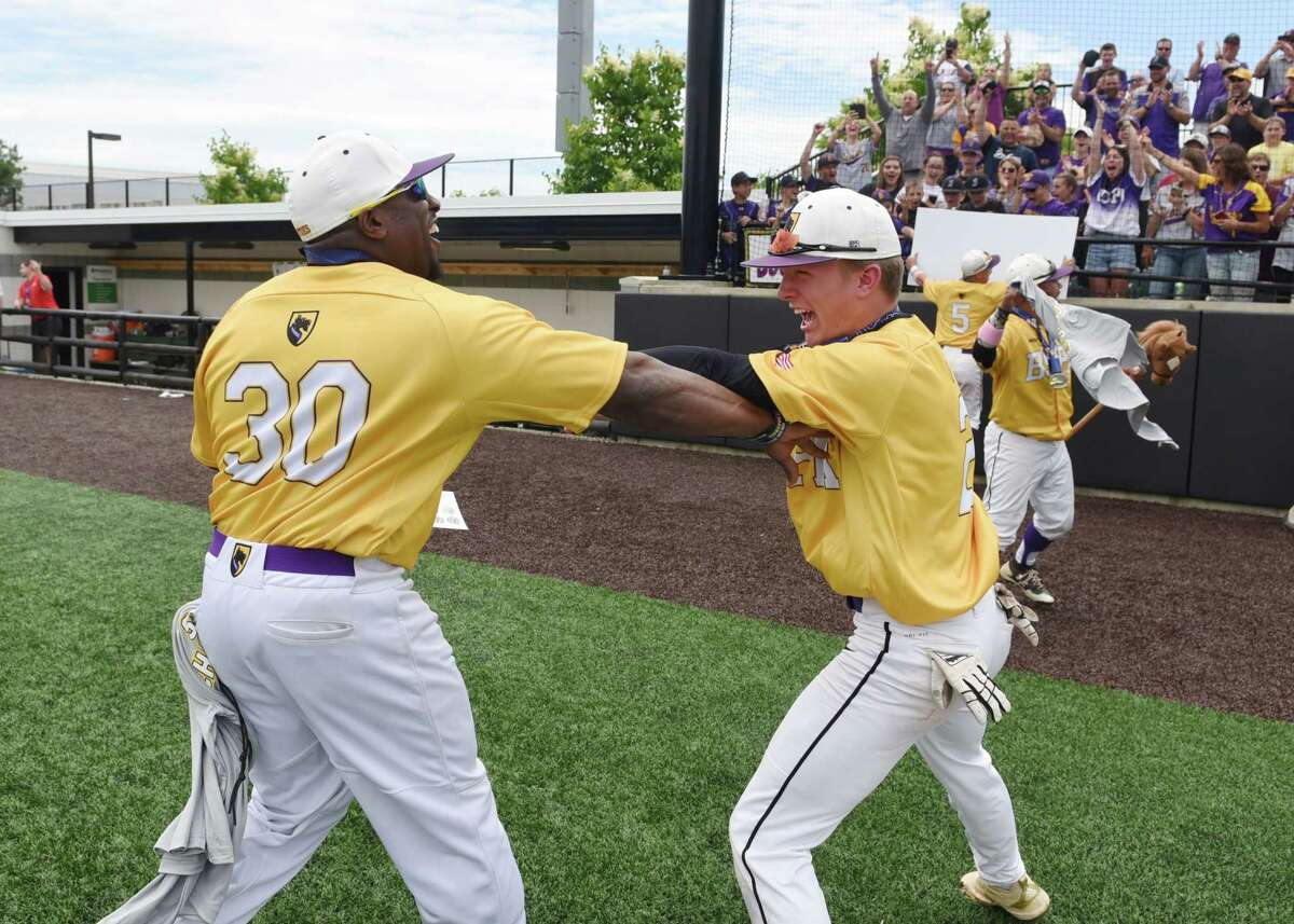 Ballston Spa Coach Curtis Nobles and Andrew O'Connor celebrate the team's win for the Class A baseball state final against Maine Endwell on Saturday, June 15, 2019 at Binghamton University in Binghamton, NY. (Phoebe Sheehan/Times Union)