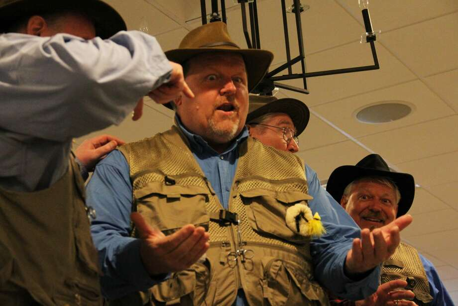 The Four Man Fishin' Tackle Choir serenades residents of Pigeon with their comedic and fishy take on the barber shop quartet genre on Thursday, June 20, 2019. This concert was the first installment of the 29th Pigeon Band Shell Concert Series. Photo: Andrew Mullin/Huron Daily Tribune