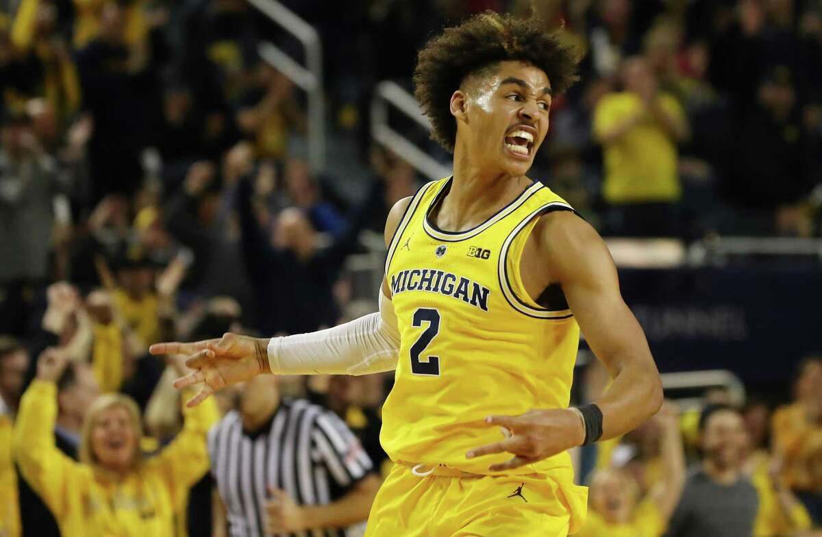 Jordan Poole #2 of the Michigan Wolverines reacts after a second half three point basket while playing the Ohio State Buckeyes at Crisler Arena on January 29, 2019 in Ann Arbor, Michigan. Michigan won the game 65-49.