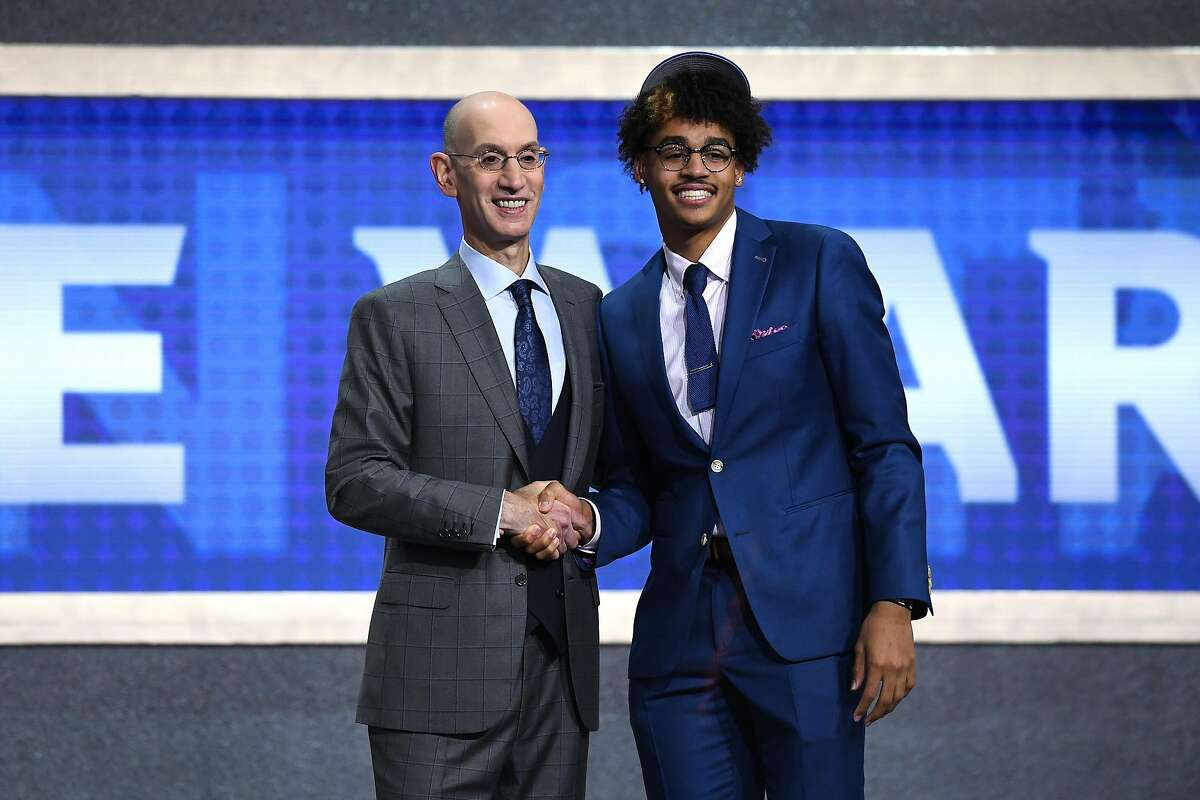 NEW YORK, NEW YORK - JUNE 20: Jordan Poole poses with NBA Commissioner Adam Silver after being drafted with the 28th overall pick by the Golden State Warriors during the 2019 NBA Draft at the Barclays Center on June 20, 2019 in the Brooklyn borough of New York City. NOTE TO USER: User expressly acknowledges and agrees that, by downloading and or using this photograph, User is consenting to the terms and conditions of the Getty Images License Agreement. (Photo by Sarah Stier/Getty Images)