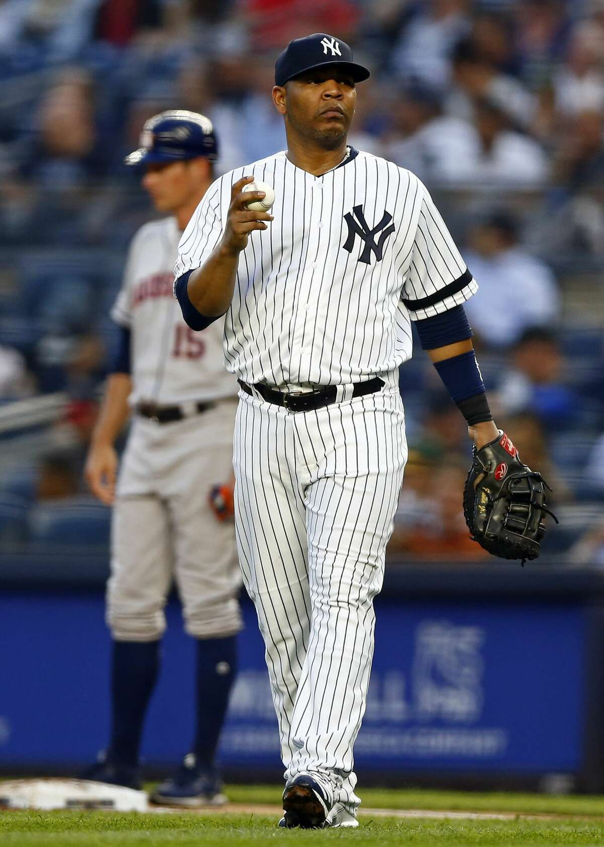 New York Yankees first baseman Edwin Encarnacion looks for a new ball during the fourth inning of a baseball game against the Houston Astros on Thursday, June 20, 2019, in New York. (AP Photo/Adam Hunger)