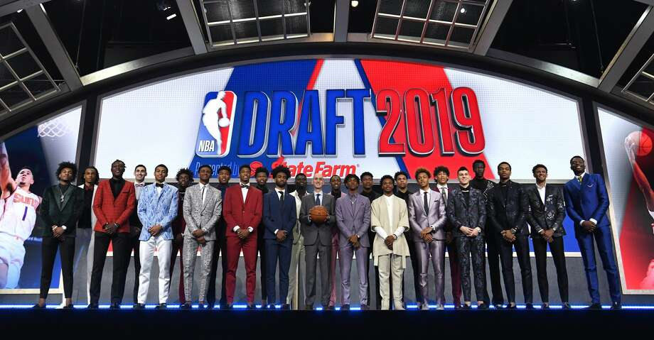 NEW YORK, NEW YORK - JUNE 20: (L-R) NBA Draft prospects Kevin Porter Jr., Nicolas Claxton, Sekou Doumbouya, Goga Bitazde, Keldon Johnson, Nassir Little, Nickeil Alexander-Walker, Rui Hachimuri, Jarrett Culver, Cam Reddish, Coby White, Zion Williamson, NBA Commissioner Adam Silver, Ja Morant, De'Andre Hunter, Darius Garland, Brandon Clarke, Romeo Langford, Jaxson Hayes, Tyler Herro, Bol Bol, PJ Washington, Matisse Thybulle and Mfiondu Kabengele stand on stage with NBA Commissioner Adam Silver before the start of the 2019 NBA Draft at the Barclays Center on June 20, 2019 in the Brooklyn borough of New York City. NOTE TO USER: User expressly acknowledges and agrees that, by downloading and or using this photograph, User is consenting to the terms and conditions of the Getty Images License Agreement. (Photo by Sarah Stier/Getty Images) Photo: Sarah Stier/Getty Images