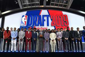 NEW YORK, NEW YORK - JUNE 20: (L-R) NBA Draft prospects Kevin Porter Jr., Nicolas Claxton, Sekou Doumbouya, Goga Bitazde, Keldon Johnson, Nassir Little, Nickeil Alexander-Walker, Rui Hachimuri, Jarrett Culver, Cam Reddish, Coby White, Zion Williamson, NBA Commissioner Adam Silver, Ja Morant, De'Andre Hunter, Darius Garland, Brandon Clarke, Romeo Langford, Jaxson Hayes, Tyler Herro, Bol Bol, PJ Washington, Matisse Thybulle and Mfiondu Kabengele stand on stage with NBA Commissioner Adam Silver before the start of the 2019 NBA Draft at the Barclays Center on June 20, 2019 in the Brooklyn borough of New York City. NOTE TO USER: User expressly acknowledges and agrees that, by downloading and or using this photograph, User is consenting to the terms and conditions of the Getty Images License Agreement. (Photo by Sarah Stier/Getty Images)