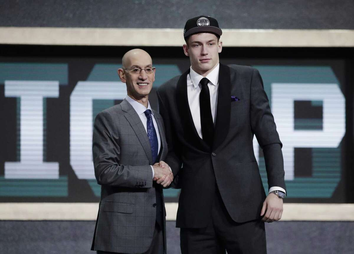 NBA Commissioner Adam Silver greets Luka Samanic of Croatia after he was selected by the Spurs.