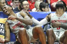 Houston Cougars guards Armoni Brooks (3) and Corey Davis Jr. (5) laugh in the final seconds of game time against Georgia State Panthers in the first round of NCAA playoffs atBOKCenter on Friday, March 22, 2019 in Tulsa. Houston won the game 84-55.