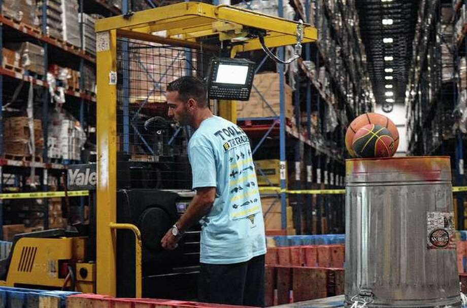 A member of Dot Foods' warehouse team competes Thursday in the distributor's Forklift Rodeo in Mount Sterling.