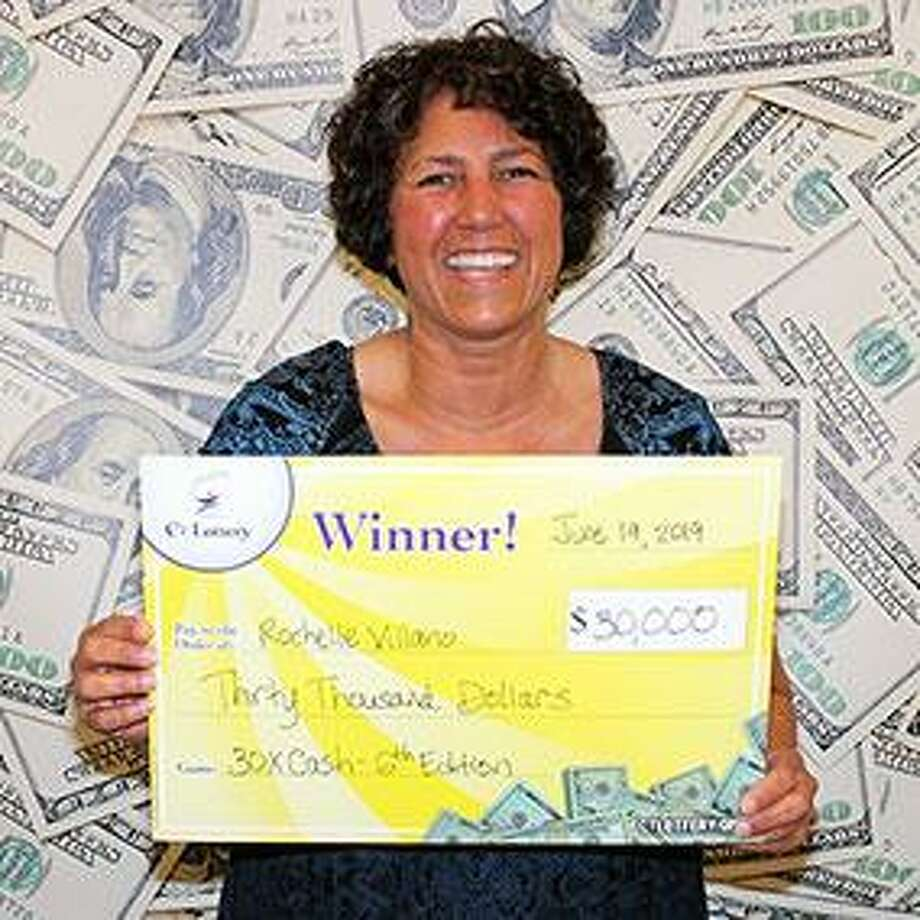 Rochelle Villano, of East Haven, won $30,000 twice by playing CT Lottery's 30X Cash game. Villano claimed a $30,000 top prize in the game's fifth edition just weeks ago on June 3. On June 19, she claimed another $30,000 prize in the game's sixth edition. Photo: CT Lottery Photo