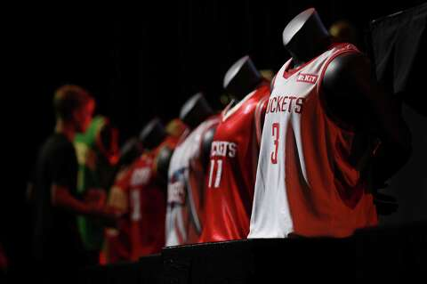 9dcb1590f57fc Previous Houston Rockets jersey designs are displayed during an event to  unveil a new team jersey