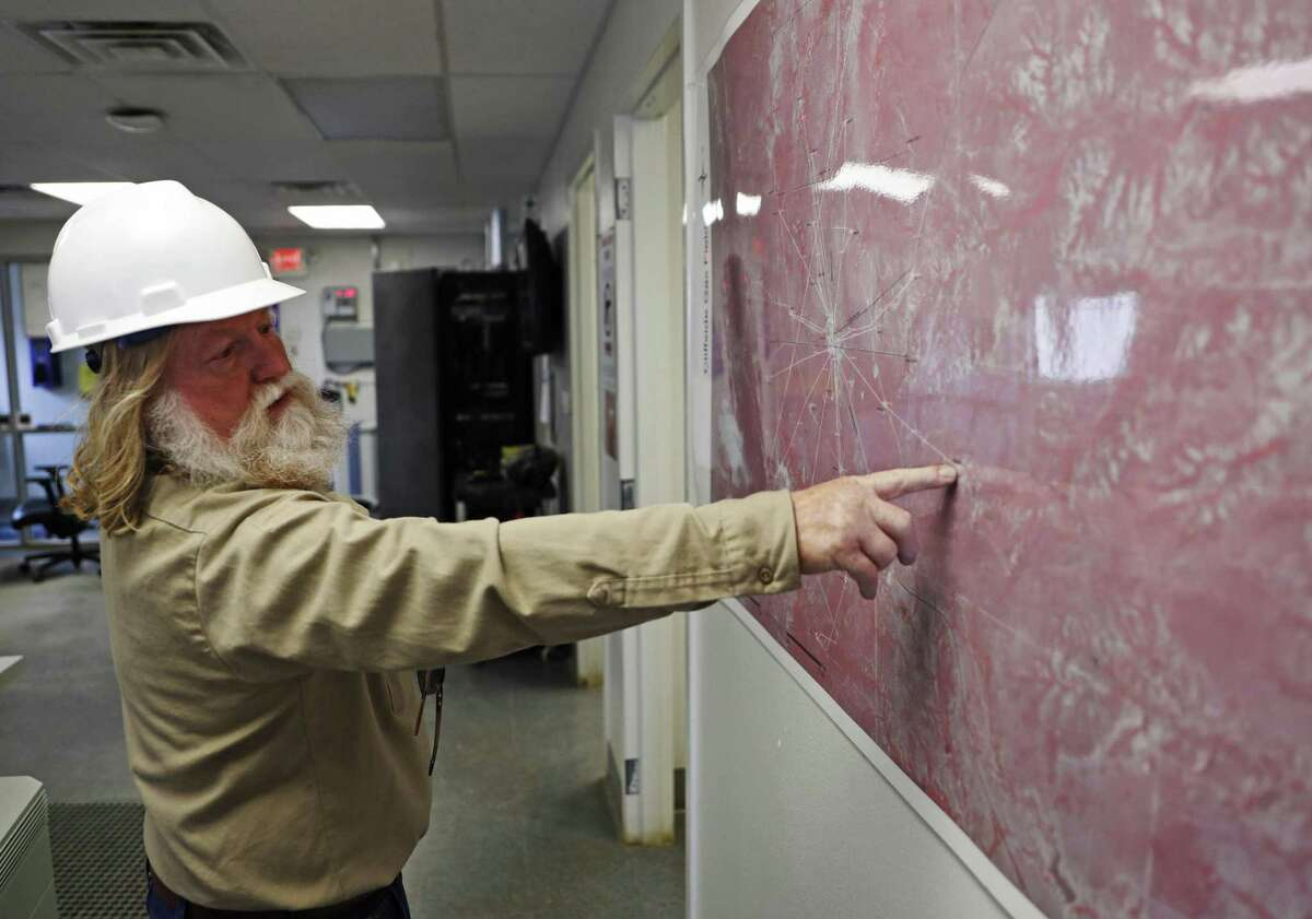 Barry Stoll, the plant manager, points out the locations of 25 gas wells on a map at the Cliffside Gas Field and Helium Enrichment Unit, Friday, May 17, 2019, in Amarillo, Texas.