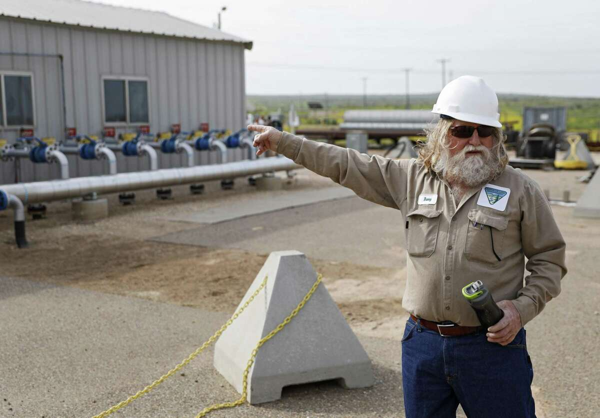 Barry Stoll, the plant manager, points out several of the incoming helium enriched gas wells during a tour of the Cliffside Gas Field and Helium Enrichment Unit, Friday, May 17, 2019, in Amarillo, Texas.