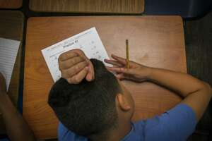 A student works on math problems during summer school classes at Michael R. Null Middle School in Sheldon Independent School District, Thursday, June 20, 2019.