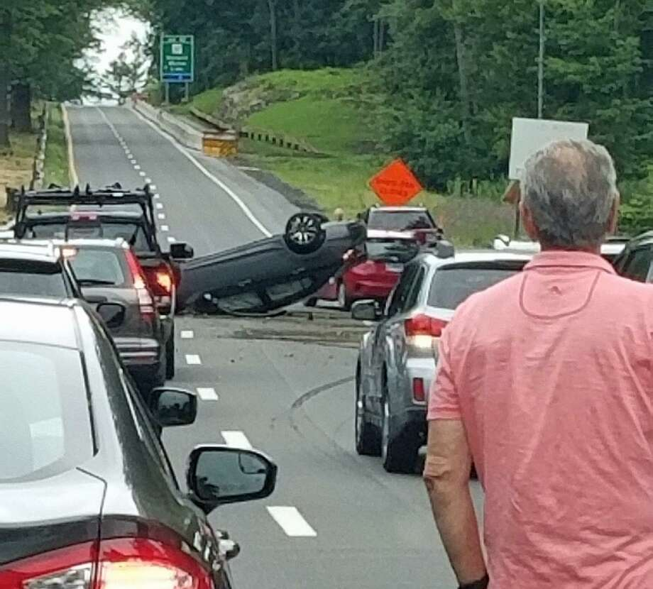 A one-vehicle rollover crash closed the southound Merritt Parkway between Fairfield and Westport on Friday, June 21, 2019. State Police said there were no serious injuries. Photo: Gail Schriffert /Contributed Photo