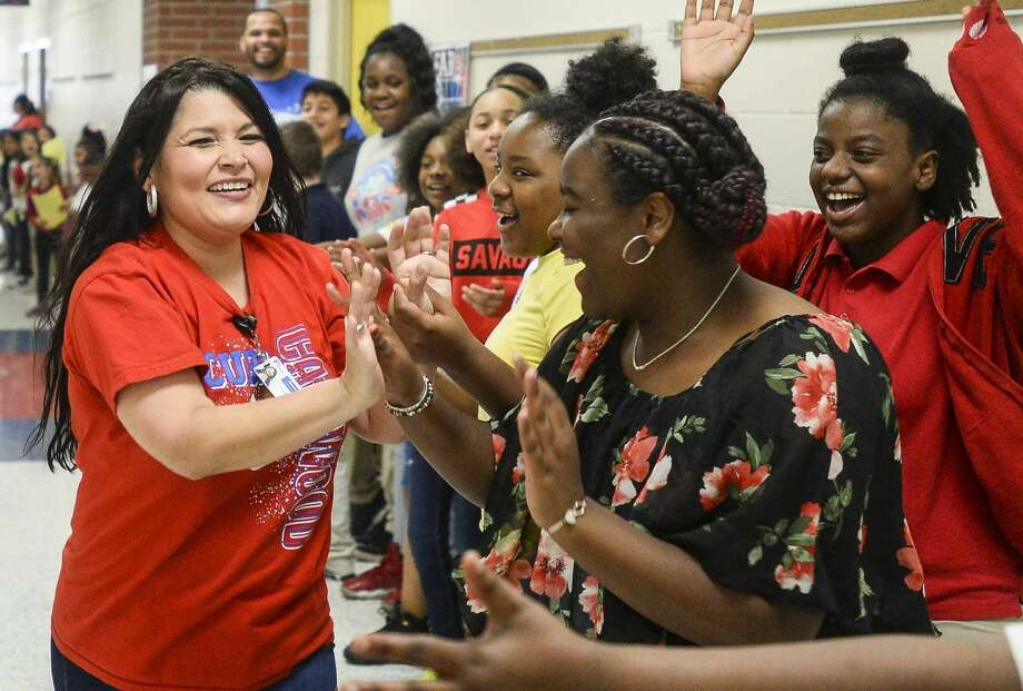 Caldwood Elementary Principle Julie Corona high fives students Thursday in the halls of the school on their last day before summer vacation. Photo taken on Wednesday, 05/22/19. Ryan Welch/The Enterprise Photo: Ryan Welch/The Enterprise