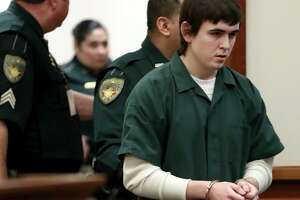 In this Feb. 25, 2019, file photo Dimitrios Pagourtzis, the Santa Fe High School student accused of killing 10 people in a May 18, 2018 shooting at the high school, is escorted by Galveston County Sheriff's Office deputies into the jury assembly room for a change of venue hearing.