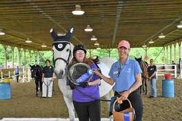 Outstanding Rider of the Year winner Allyson Schroeder, left, Pegasus program director Betsy Stein Medinger, and horse Bo.