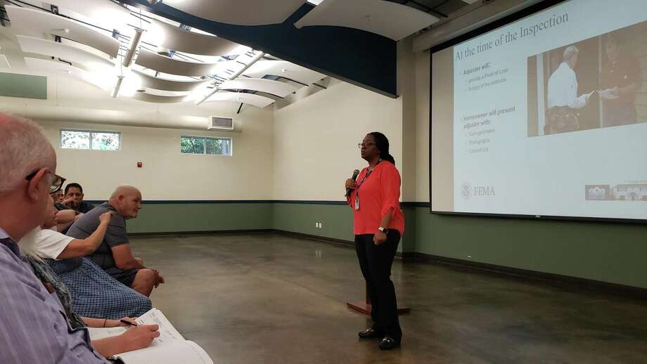 Angela Harrison, a flood insurance specialist with FEMA, answers questions about the flood insurance claims process at the Kingwood Community Center on June 19, 2019. Photo: Kaila Contreras