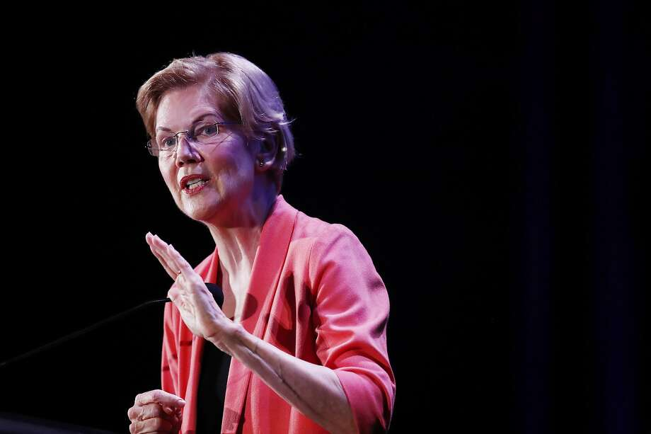 Democratic presidential candidate Sen. Elizabeth Warren, D-Mass., speaks at a forum in Miami. She says the companies running detention centers regularly sacrifice safety. Photo: Brynn Anderson / Associated Press