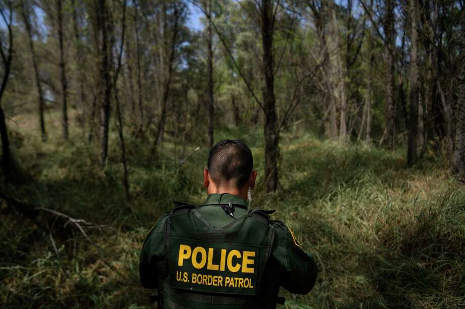 U.S. Border Patrol Agent Marcelino Medina walks through the brush listening and looking for signs of people crossing the Rio Grande illegally in McAllen, Texas on June 20, 2019. Photo: Washington Post Photo By Carolyn Van Houten / The Washington Post