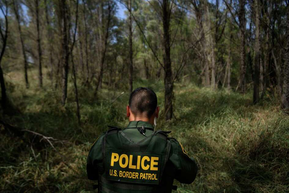U.S. Border Patrol Agent Marcelino Medina walks through the brush listening and looking for signs of people crossing the Rio Grande illegally in McAllen, Texas on June 20, 2019.