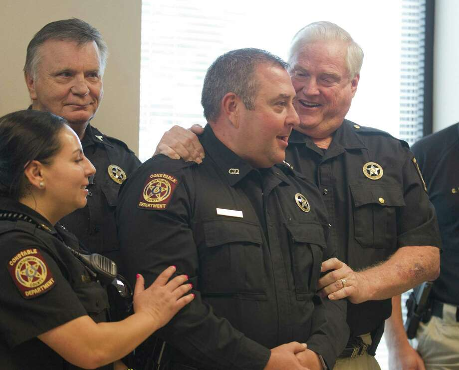 Montgomery County Precinct 5 Constable Chris Jones was appointed to fill the unexpired term of former Constable David Hill 9 (left) during a Montgomery County Commissioners Court meeting in September. Photo: Jason Fochtman, Houston Chronicle / Staff Photographer / © 2018 Houston Chronicle