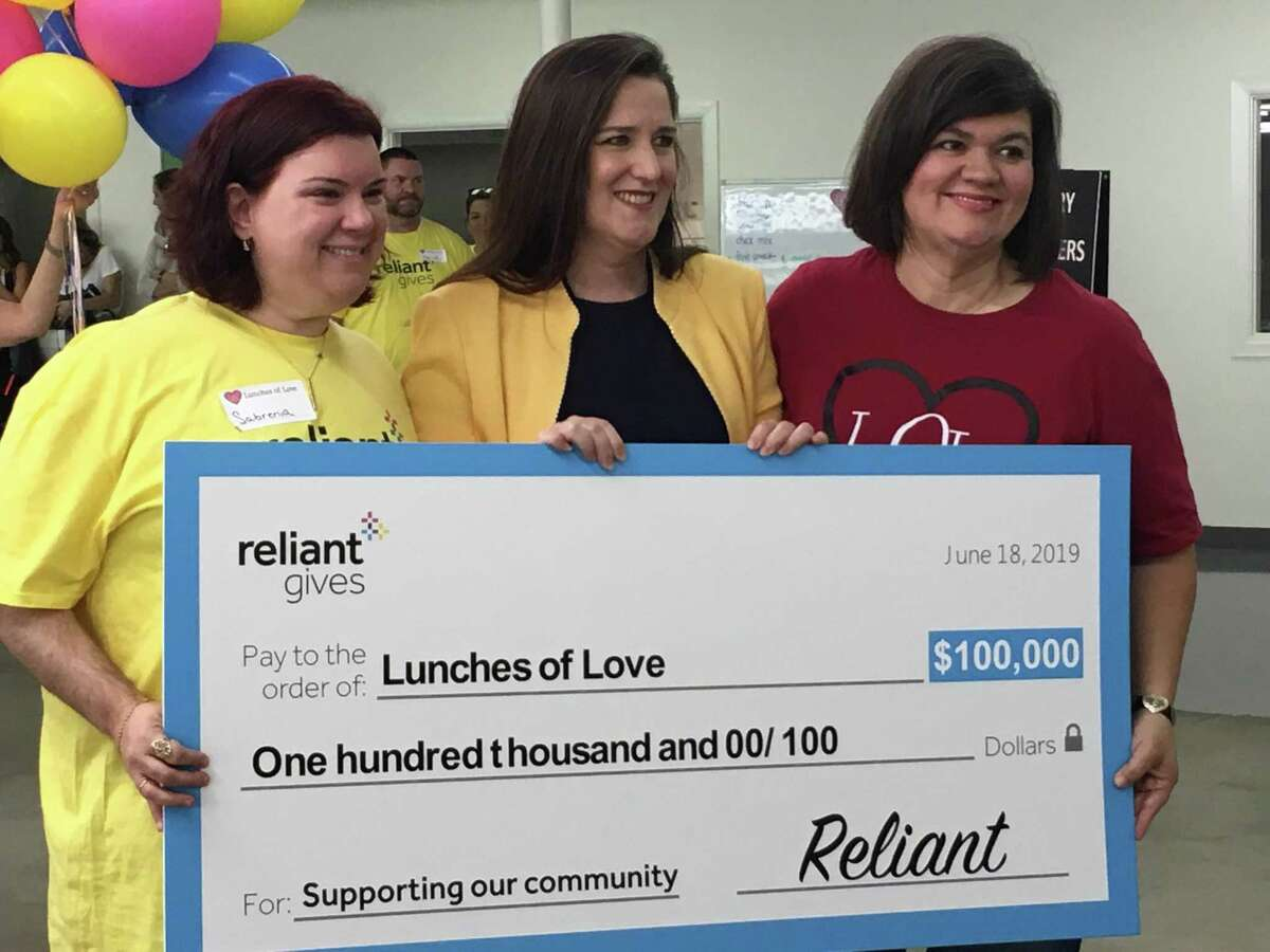 Lunches of Love received $100,000 June 18 through Reliant Gives Vote, a Reliant crowd-sourced, charitable giving program. From left are Sabrenia Baxter, a Reliant employee and Lunches of Love volunteer; Elizabeth Killinger, Reliant president; and Adriane Gray, who created Lunches of Love. Baxter nominated Lunches of Love for Reliant Gives Vote.
