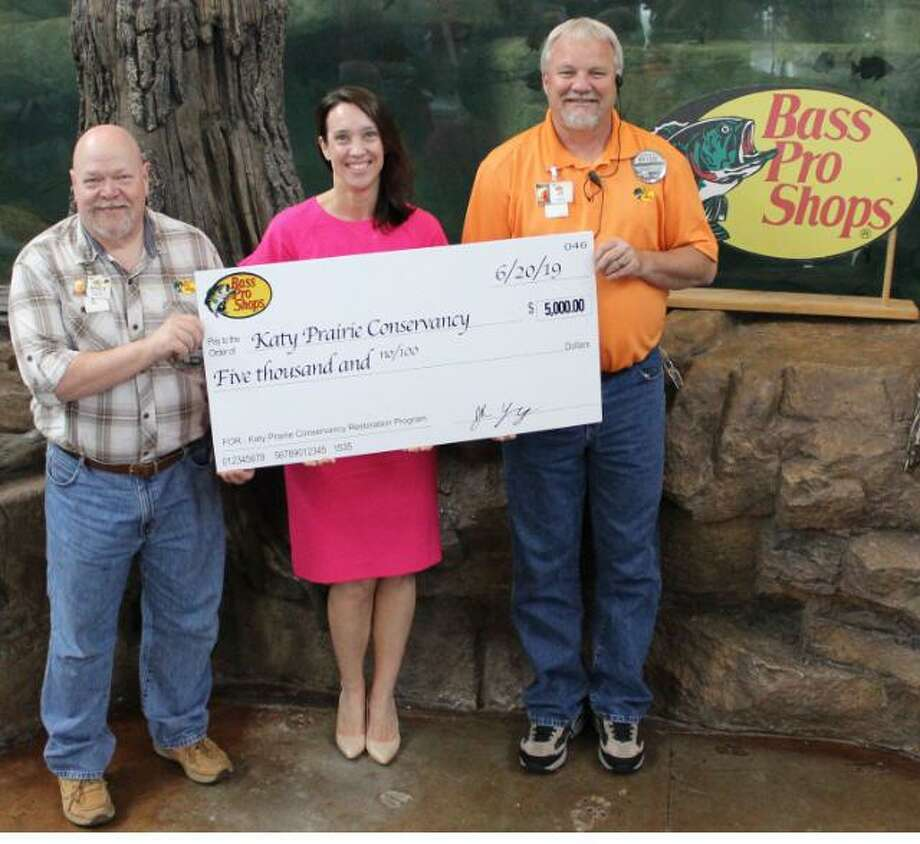 Bass Pro Shops donated $5,000 to the Katy Prairie Conservancy on June 20 to restore and enhance the Katy Prairie. From left areAndy Wohlgemuth, community coordinator Bass Pro Shops; Ali Dodson, advancement director Katy Prairie Conservancy; and JR Young, general manager Bass Pro Shops Katy. Photo: Courtesy Bass Pro Shops Katy / Courtesy Bass Pro Shops Katy