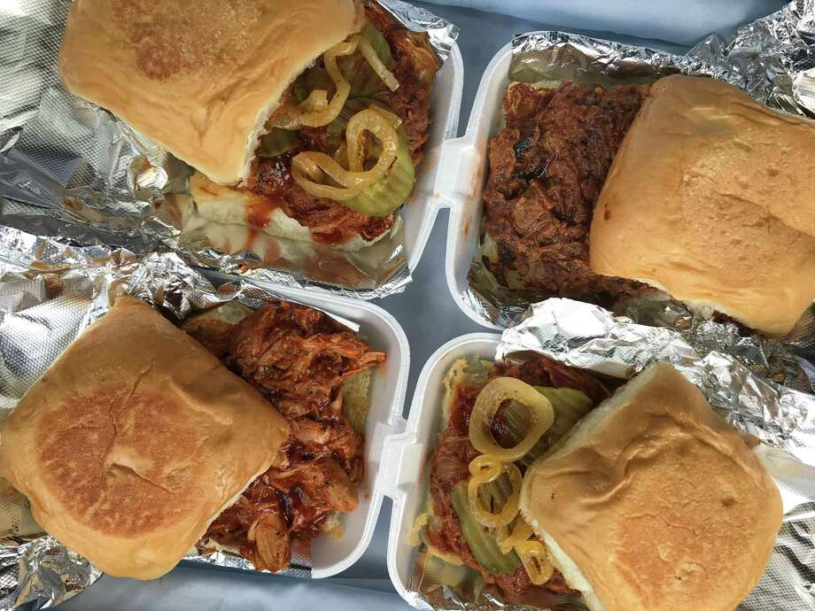 A lineup of barbecue sandwiches from Papa's Quickdraw BBQ, located at 12054 Blanco Road on San Antonio's North Side. Photo: Paul Stephen /Staff File Photo