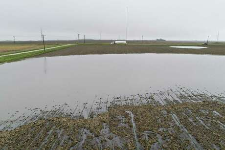 Farmland in Tiskilwa, Ill., sits under water last month. The fear of a steep rise in the price of livestock feed is shaking markets, though about 2 billion bushels of corn are in storage in the U.S.