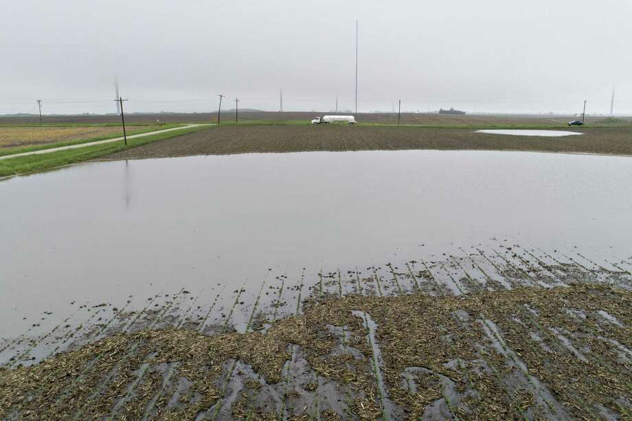 Farmland in Tiskilwa, Ill., sits under water last month. The fear of a steep rise in the price of livestock feed is shaking markets, though about 2 billion bushels of corn are in storage in the U.S. NEXT: See places where the climate is worsening. Photo: Daniel Acker /Bloomberg / © 2019 Bloomberg Finance LP