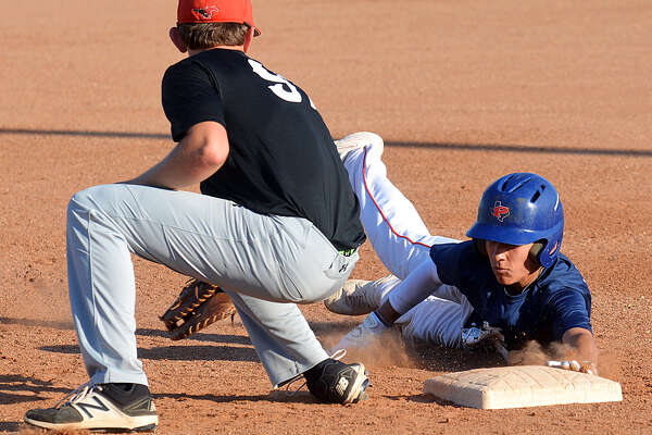 Plainview baserunner Devin Rogers dives safely back into first before the Shallowater defender can apply the tag.
