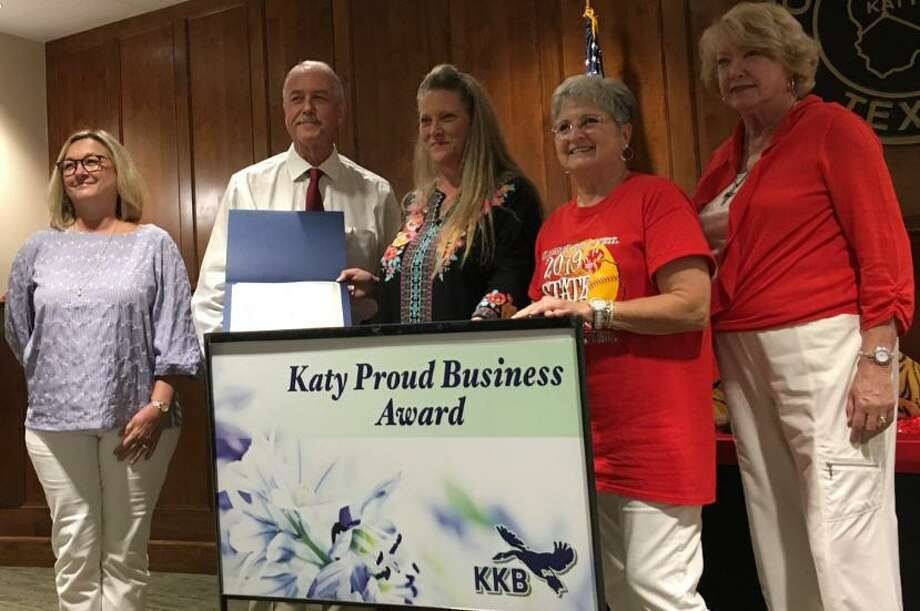 Keep Katy Beautiful recognized Old Town Katy Floral as the recipient of the Katy Proud Business Award on June 17. From left are Jennifer Stence, KKB board member; Katy Mayor Bill Hastings; Vicki Wiggins, owner of Old Town Floral; Sandy Schmidt, chairman of the KKB board of directors; and Kay Callender, vice chairman of the KKB board of directors. Photo: Karen Zurawski / Karen Zurawski