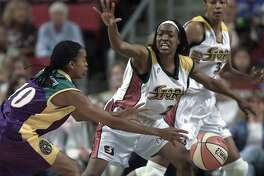 Seattle-08/09/00-Seattle Storm 's #21 Charmin Smith tries to block pass by Los Angeles Sparks #10 Nicky McCrimmon in the 1st half.. Photo by Paul Kitagaki Jr./Seattle Post-Intelligencer (For Sports section - no reporter assigned)
