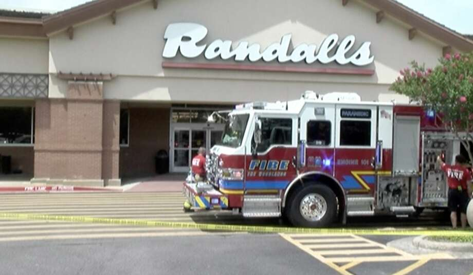 Firefighters work to make sure the Randalls in The Woodlands is safe after a refrigerant pipe ruptured and critically injured a worker Friday, June 21, 2019. Photo: Scott Engle / Montgomery County Police Reporter