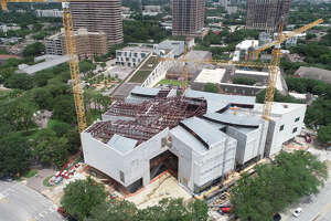McCarthy Building Cos. and the Museum of Fine Arts, Houston recently celebrated the topping out of the Nancy and Rich Kinder Building Monday. The building, which will have a translucent-glass exterior, will open next year to house modern and contemporary art.