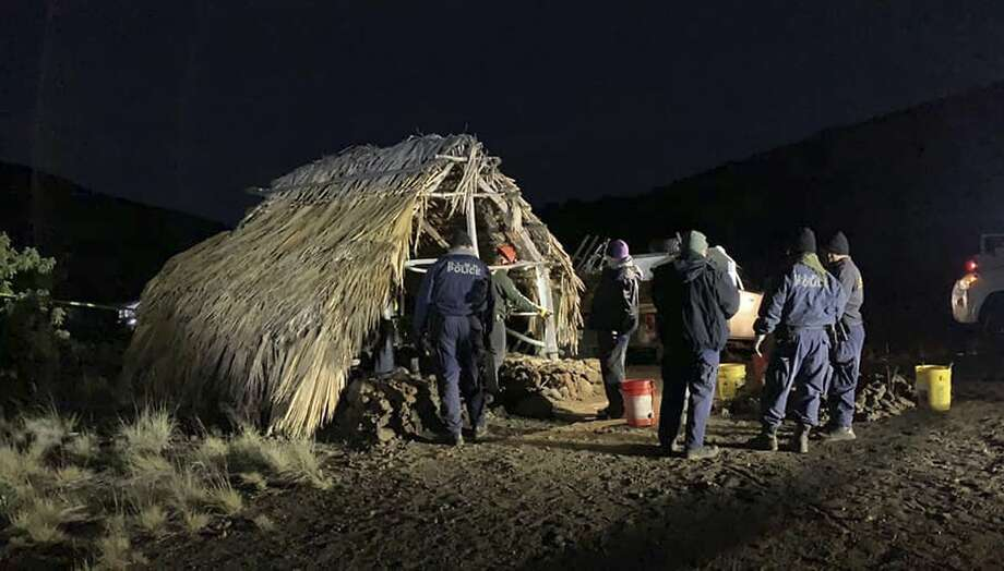 State and county officials remove Native Hawaiian structures from Mauna Kea on Thursday. After years of protests and legal battles, Hawaii officials have approved construction of a major telescope at the site. Photo: Pi'ikea Keawekane-Stafford