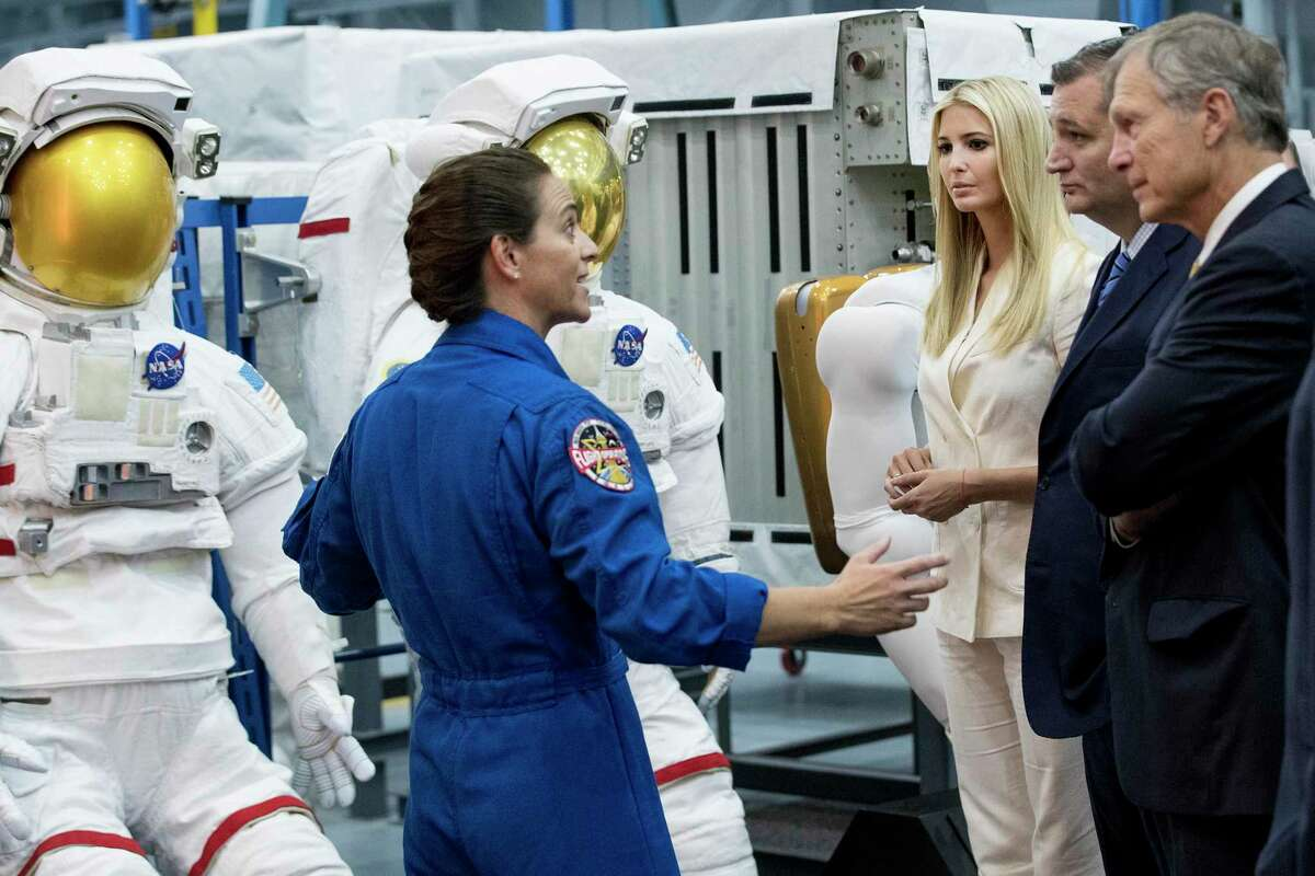 Astronaut Nicole Mann, left, talks to Ivanka Trump, senior adviser to the president, Sen. Ted Cruz, and Rep. Brian Babin, about a line of space suits as she gives a tour of the Space Vehicle Mockup Facility at NASA's Johnson Space Center on Sept. 20, 2018, in Houston.