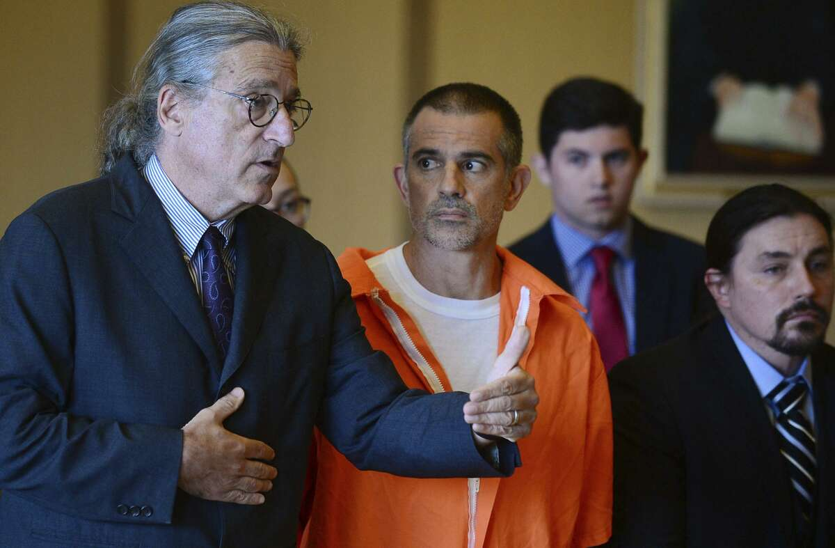 Fotis Dulos, center, listens, as his attorney Norm Pattis, left, addresses the court during a hearing at Stamford Superior Court, Tuesday, June 11, 2019 in Stamford, Conn. Fotis Dulos, and his girlfriend, Michelle Troconis, have been charged with evidence tampering and hindering prosecution in the disappearance of his wife Jennifer Dulos. The mother of five has has been missing since May 24.