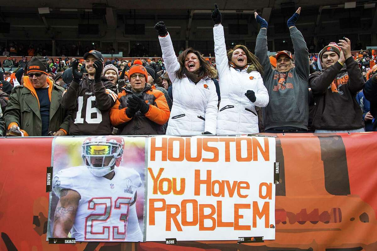 """In a scene played out at opposing stadiums around the country, Cleveland Browns fans cheer behind a sign reading, """"Houston You Have a Problem,"""" a popular culture reference to Apollo 13, during the second half of a Houston Texans victory at FirstEnergy Stadium on Sunday, Nov. 16, 2014, in Cleveland."""